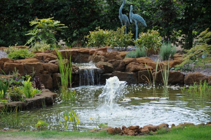 Carrstone koi pond with waterfall, fountain and landscaping
