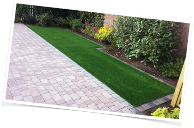 Artificial lawn and paving installation